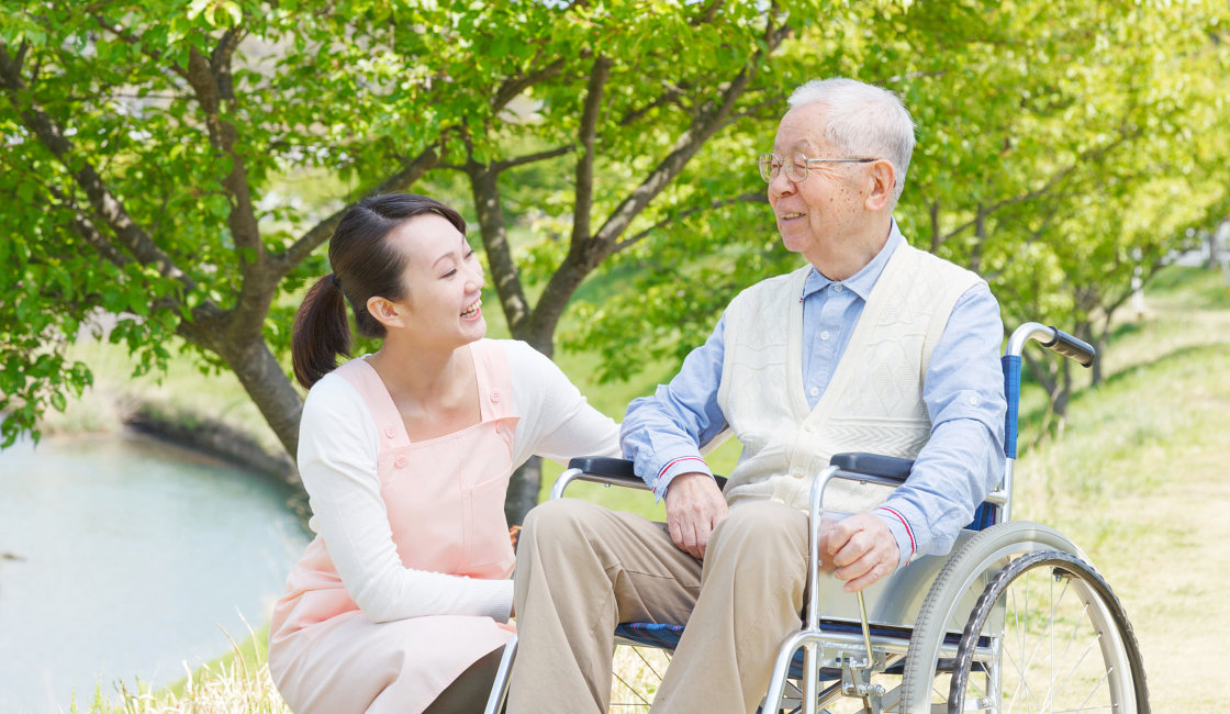 caregiver and patient in the park