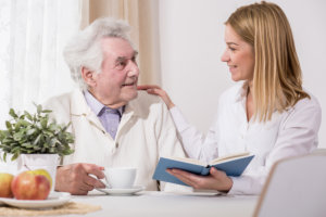 caregiver reminding the patient about his medication